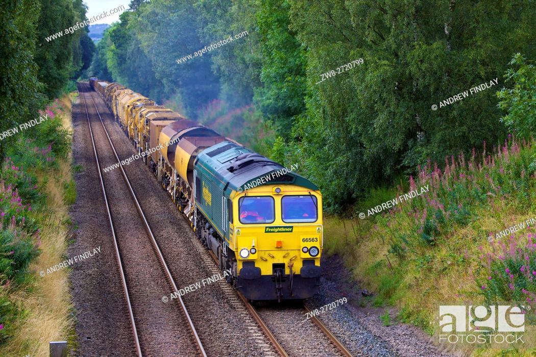 Stock Photo: Class 66 Freightliner freight train. Traveling east. Morralee, Bardon Mill, Newcastle & Carlisle Railway (N&CR), Northumberland, England, United Kingdom, Europe.
