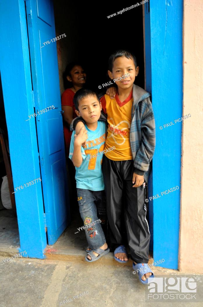 Stock Photo: Two young nepalis boys posing, the nepalis, life in kathmandu, kathmandu street life, nepal.