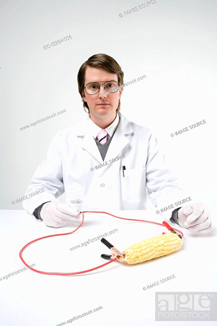 Stock Photo: Scientist with sweetcorn and lightbulb.