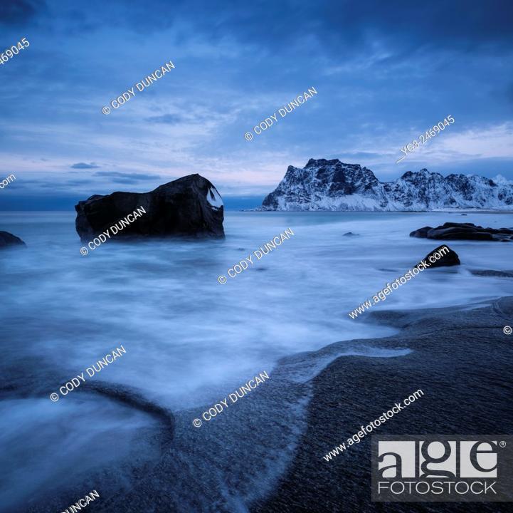 Stock Photo: Rocky shore of Uttakleiv beach in winter, Vestvågøy, Lofoten Islands, Norway.