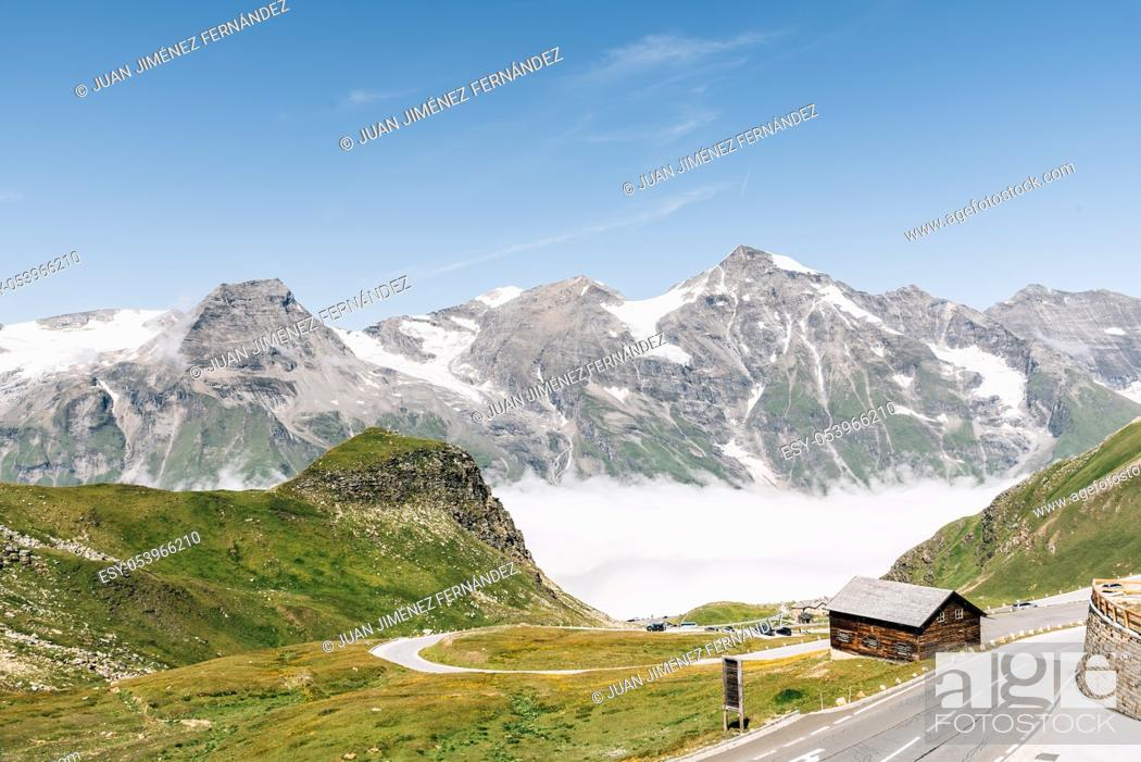 Stock Photo: Scenic view of Alpine road through valley with sea of clouds. Grossglockner, Austria. Space for copy.