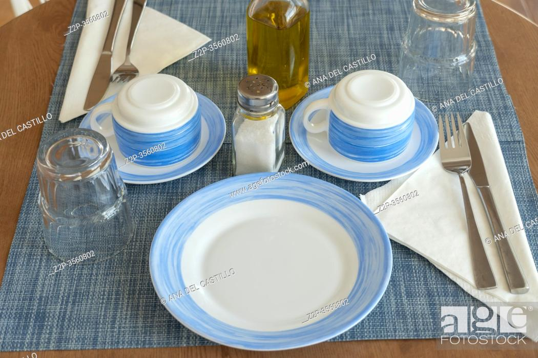 Stock Photo: Breakfast tableware for a couple on round table in summer flat Spain.