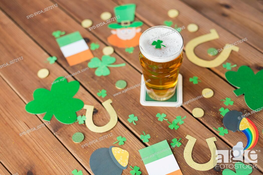 Stock Photo: glass of beer and st patricks day party props.