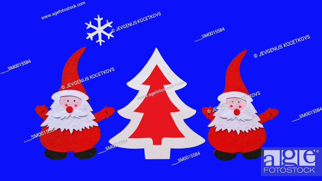 Stock Photo: Drawing of Santa Claus and Christmass tree made of glued pieces of felt and plywood on a blue background, hand-made.