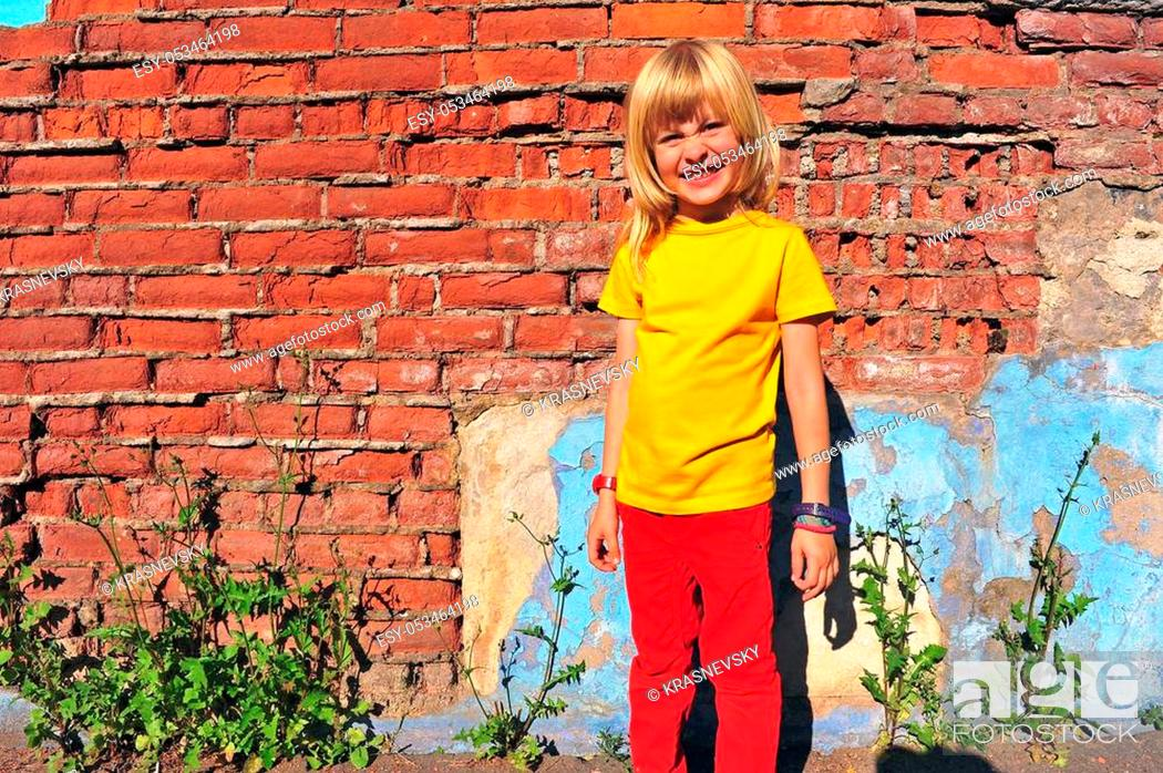 Stock Photo: Portrait of a smiling kid wearing yellow t-shirt.