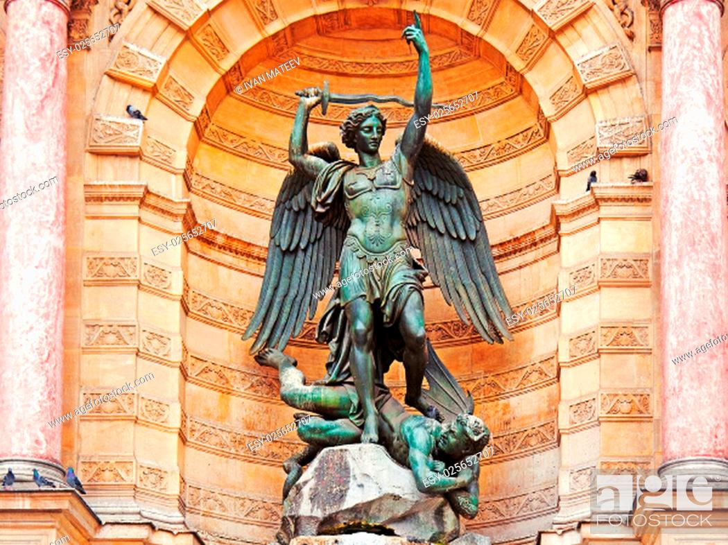 Stock Photo: The statue of Saint Michael atop the fountain in the Place Saint-Michel at the northern end of the Boulevard Saint-Michel.