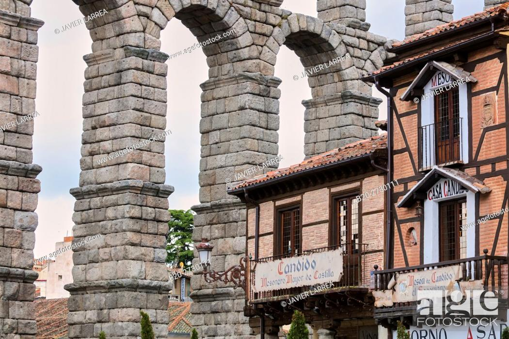 Stock Photo: Spain, Castile-Leon, Segovia, Roman Aqueduct and famous Meson de Candido restaurant.