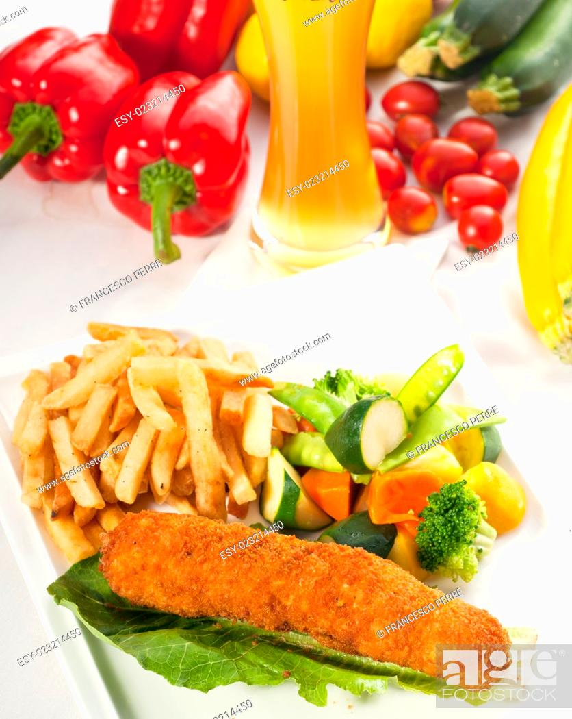 Stock Photo: fresh breaded chicken breast roll and vegetables, with lager beer and fresh vegetables on background.