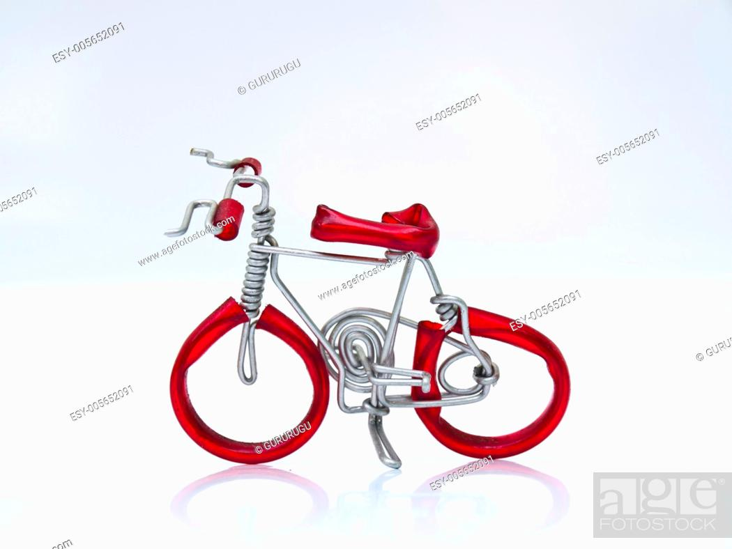 Stock Photo: A red miniature bike handicraft model from Thailand.