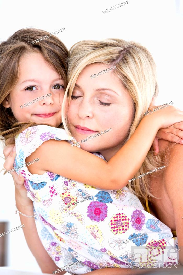 Stock Photo: Germany, Mother and daughter embracing.