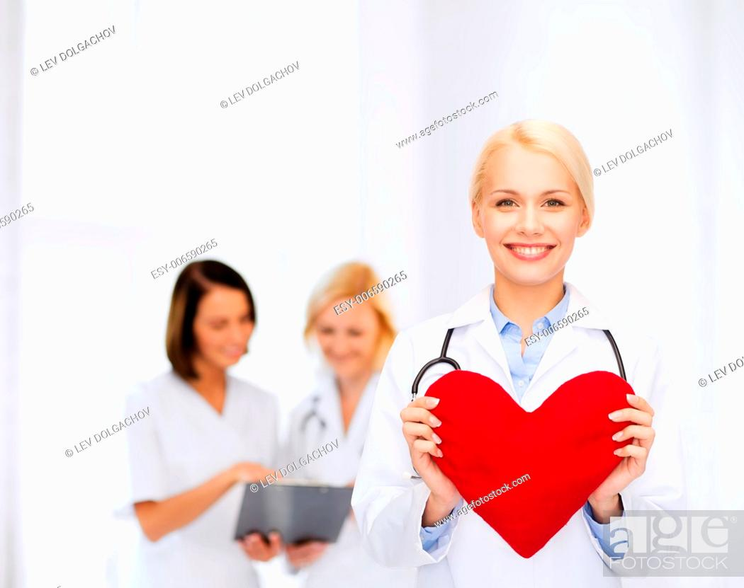 Stock Photo: healthcare and medicine concept - smiling female doctor with heart and stethoscope.