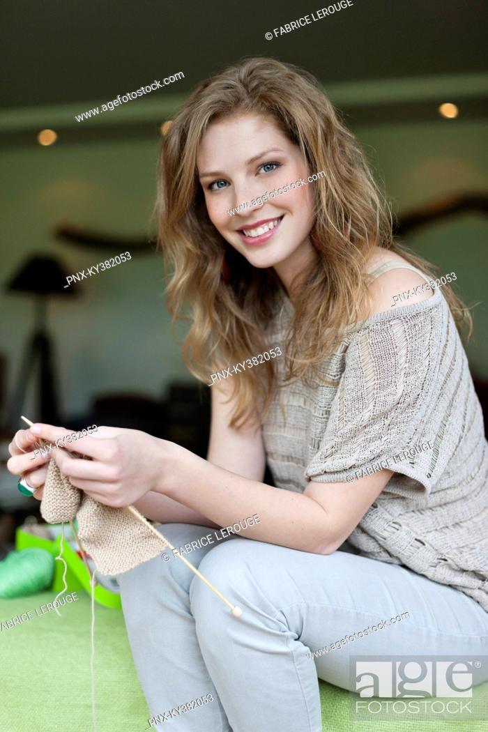 Stock Photo: Woman knitting.