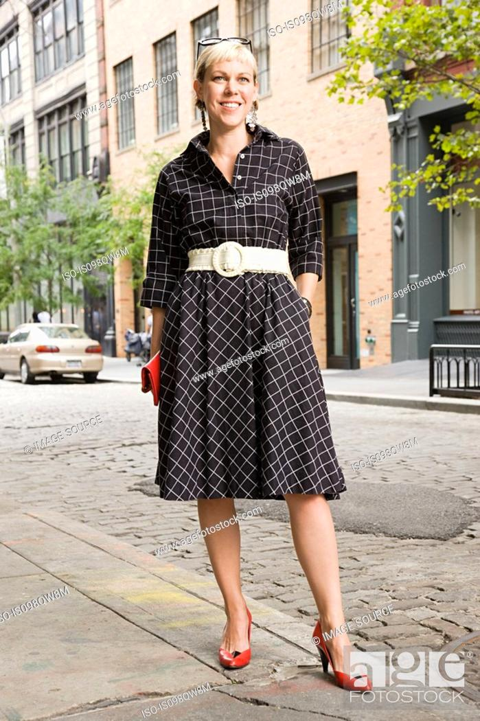 Stock Photo: Portrait of woman in street.