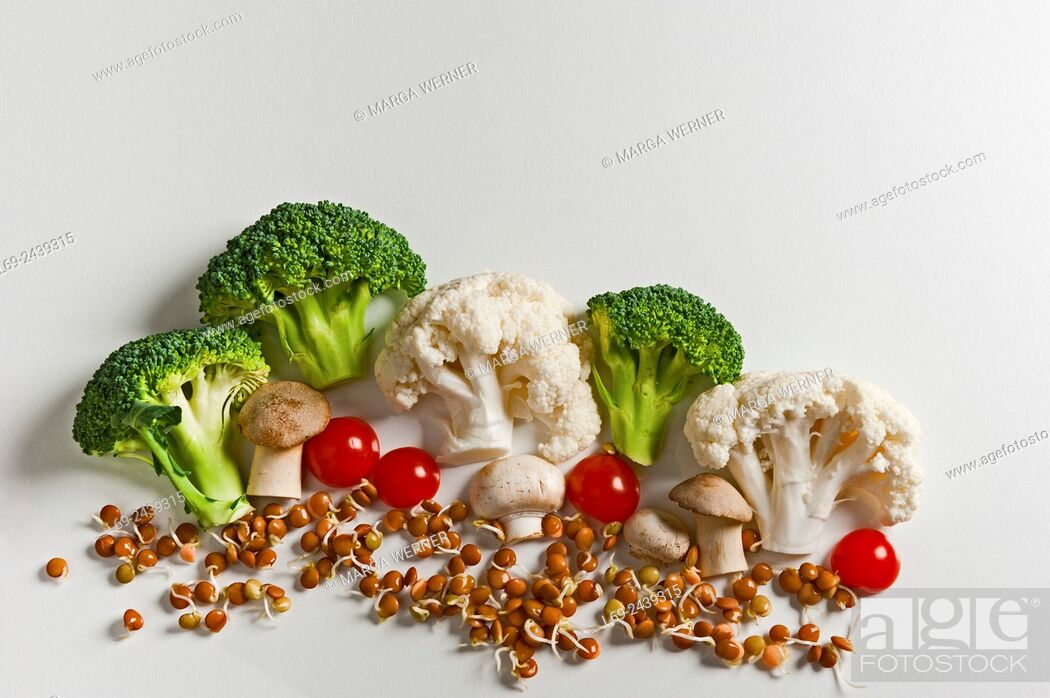 Stock Photo: Vegetable landscape with cauliflower, broccoli, white mushroom, tomato and bed from lentil sprouts.
