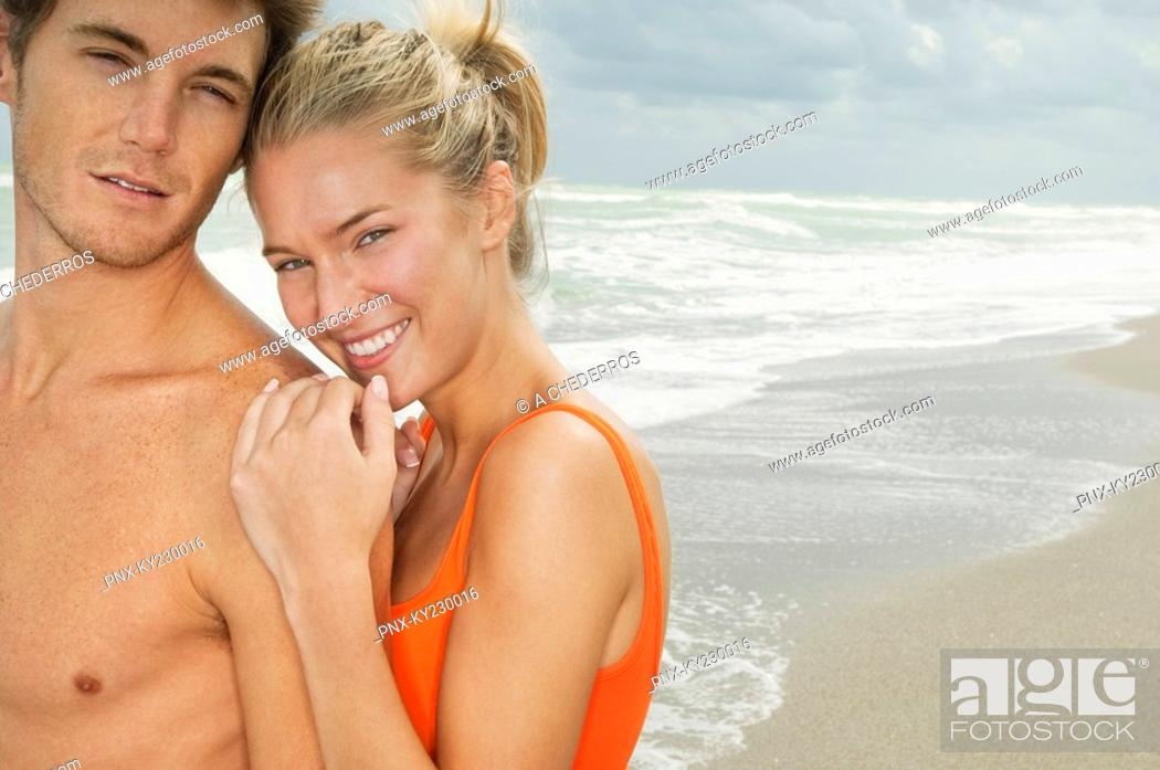 Stock Photo: Portrait of a couple smiling on the beach.