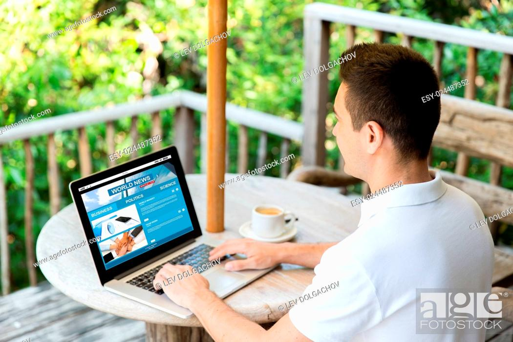 Stock Photo: business, mass media, people and technology concept - close up of businessman typing on laptop with news web site on screen outdoors on summer terrace and.
