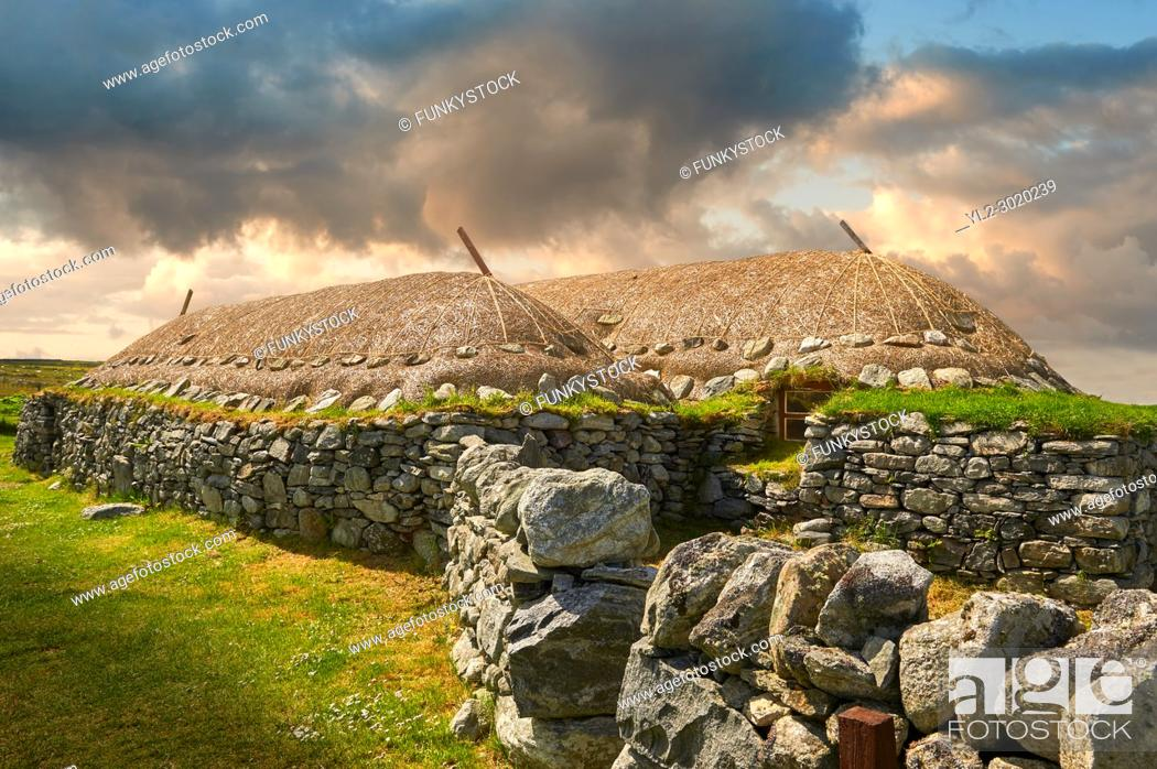 Stock Photo: Picture & image of the exterior with stone walls and thatched roof of The historic Blackhouse, 24 Arnol, Bragar, Isle of Lewis, Scotland.