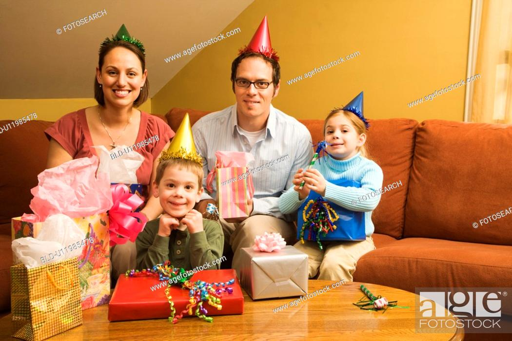 Stock Photo: Caucasian family celebrating a birthday party and looking at viewer.