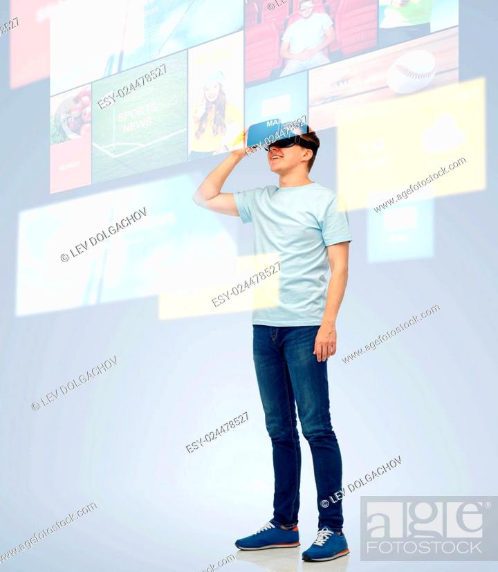 Stock Photo: 3d technology, virtual reality, entertainment, cyberspace and people concept - happy young man with virtual reality headset or 3d glasses looking at screen with.