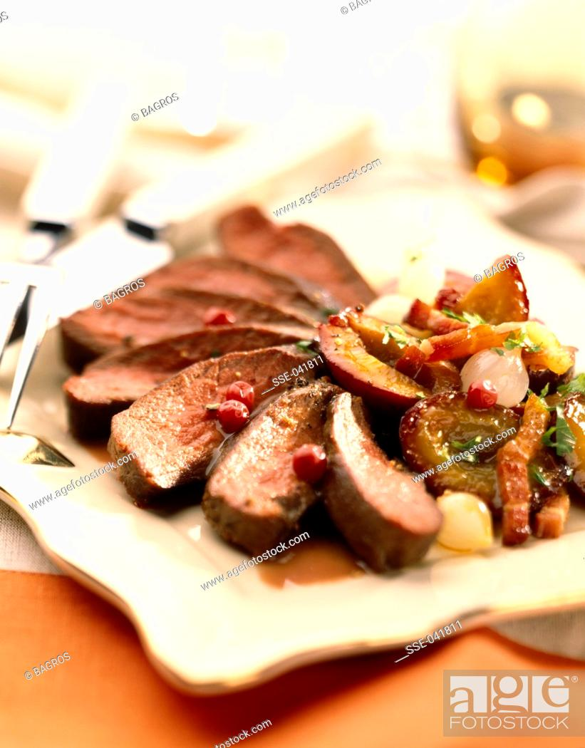 Stock Photo: fillet of duck's breast with plums.
