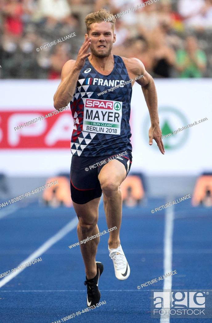 Stock Photo: 07.08.2018, Berlin: Track and Field: European Championships at the Olympic Stadium, decathlon 100m, Men. Kevin Mayer from France crosses the finish line.