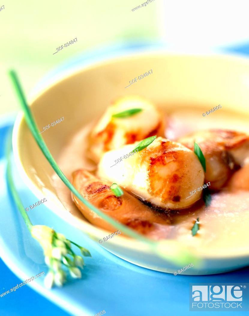 Stock Photo: scallop nage soup.