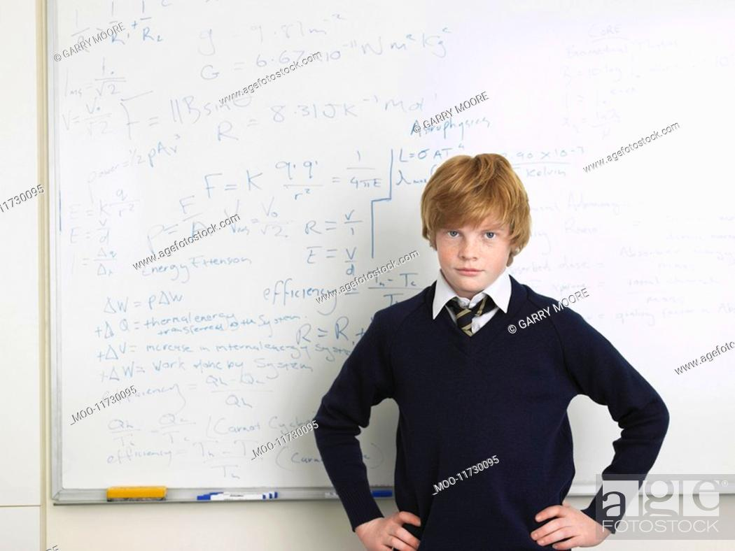 Stock Photo: Elementary school student standing by whiteboard in math class portrait.