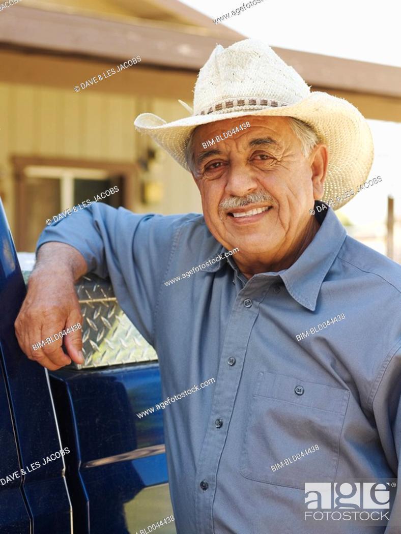 Stock Photo: Senior Hispanic man wearing cowboy hat.