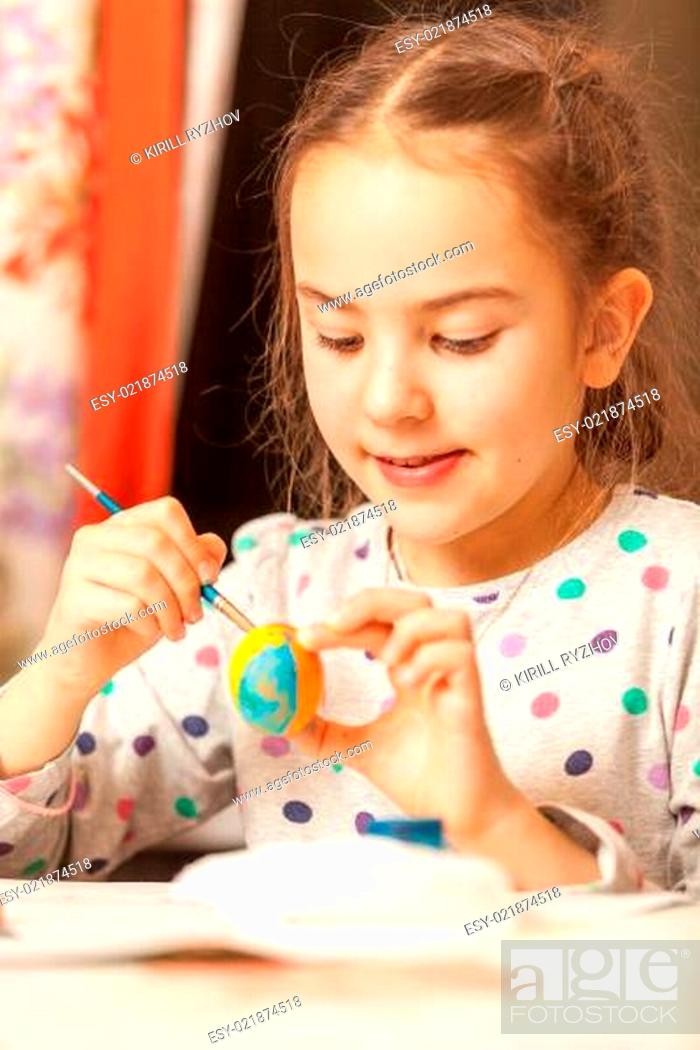 Stock Photo: Portrait of girl painting easter eggs.