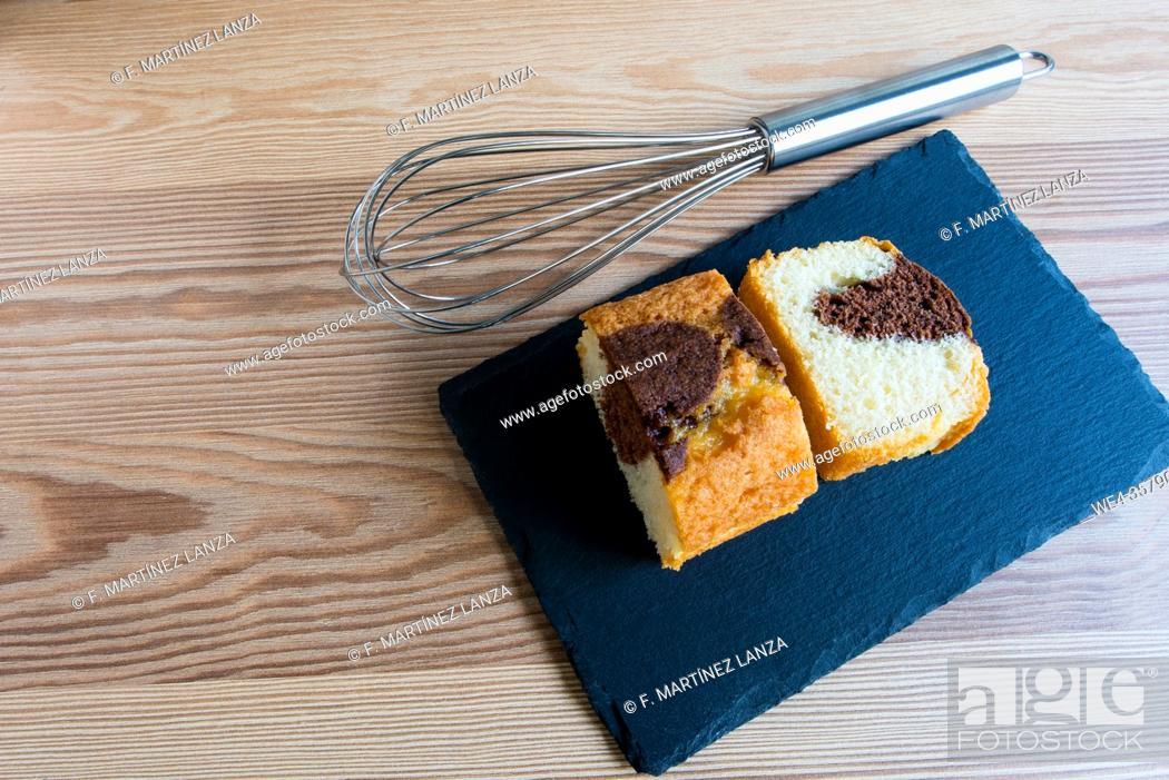 Stock Photo: Homemade chocolate cake and kitchen whisk.
