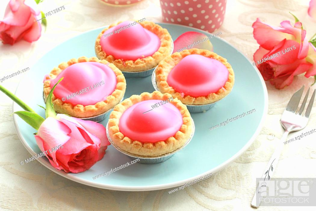 Stock Photo: Pink cakes on blue plate.