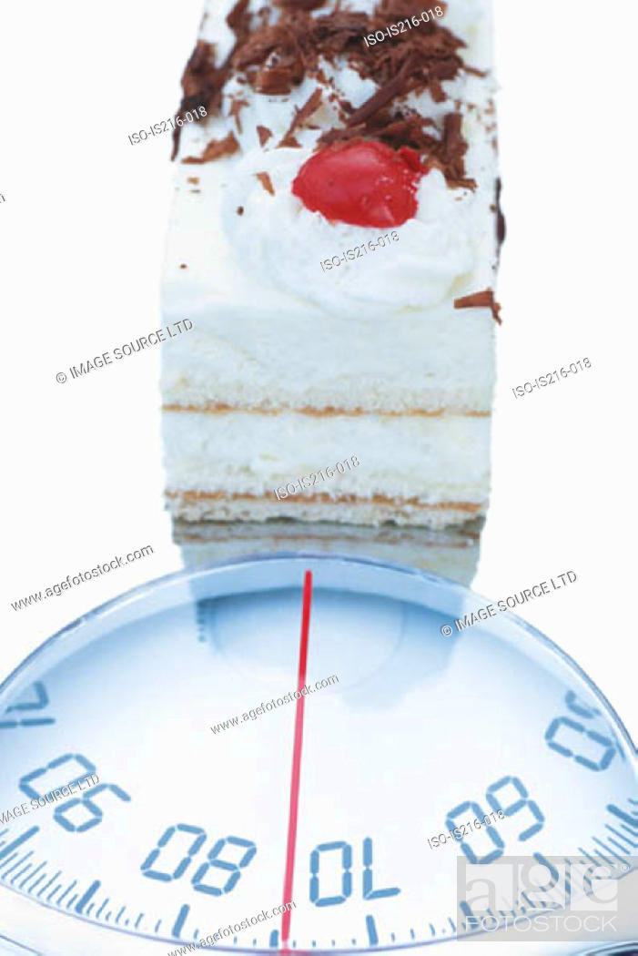 Stock Photo: Cake and scales.