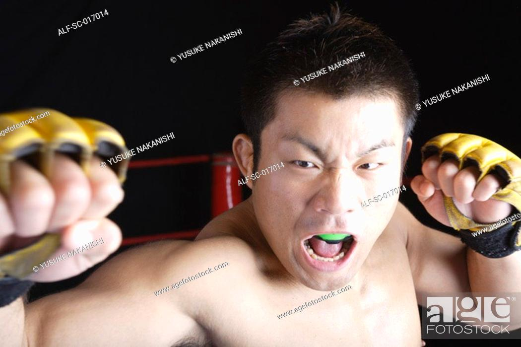 Stock Photo: Mixed Martial Arts Fighter With His Defence open.