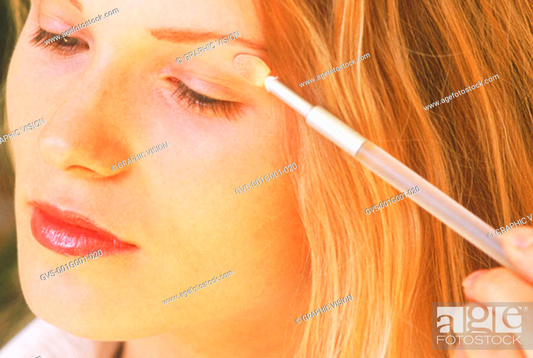 Stock Photo: Close up of a Woman Applying Eye Makeup.