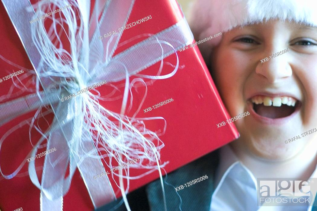 Stock Photo: cheerful boy with present.