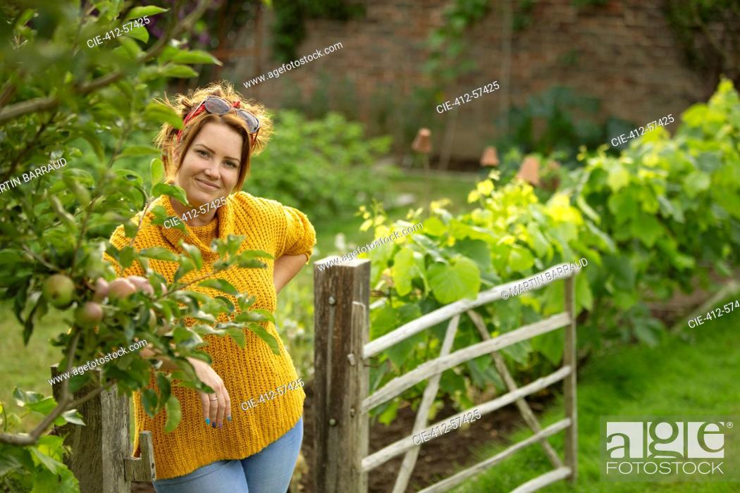 Stock Photo: Portrait happy woman in vegetable garden.