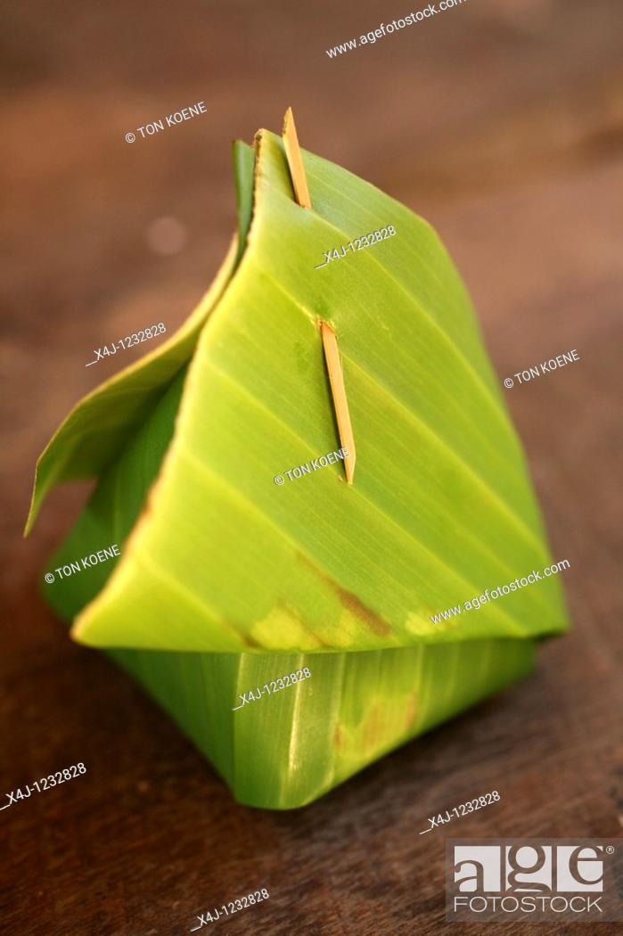 Stock Photo: traditional thia food in banana leave.