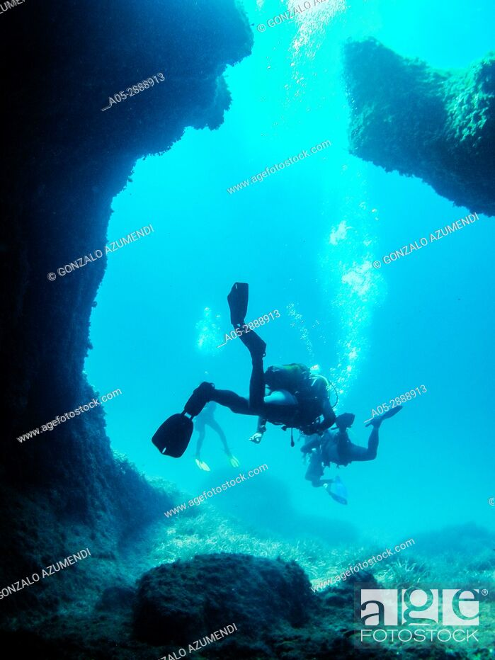 Stock Photo: Diving in the coast of Binibeca. The place is full of caves, named catedral. Sant Lluis Municipality. Minorca. Balearic Islands. Spain.