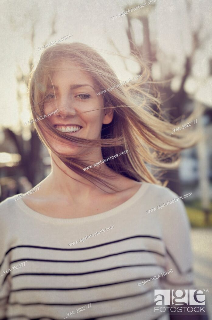 Stock Photo: Smiling young adult woman portrait.