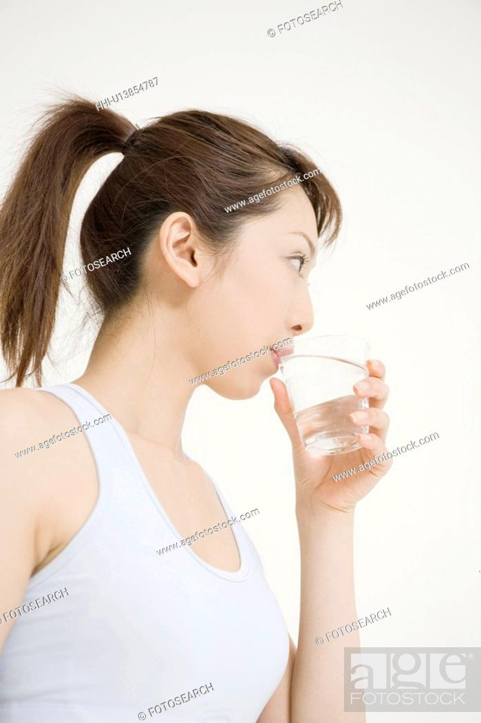 Stock Photo: Woman who drinks water.