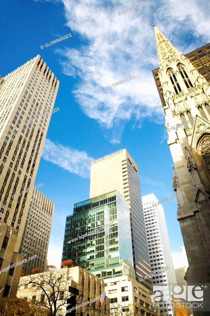 Stock Photo: Low angle view of skyscrapers in a city, St  Patrick's Cathedral, Manhattan, New York City, New York State, USA.