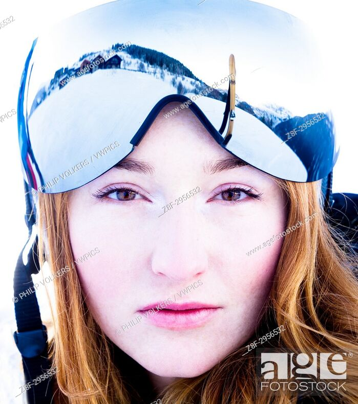 Photo de stock: Ginger young woman wearing ski glasses in the Alps.