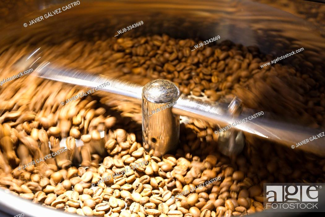 Stock Photo: Freshly roasted coffee beans cooling.