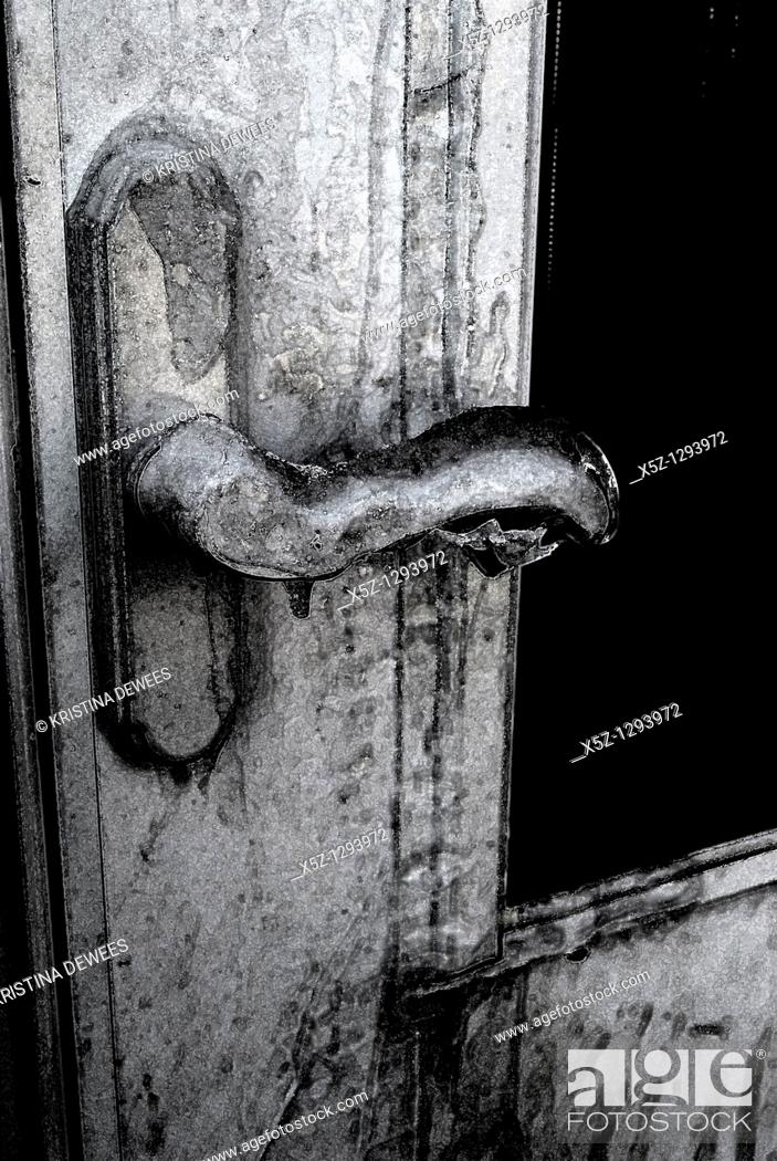 Stock Photo: An ice covered door handle in the Winter with effects.