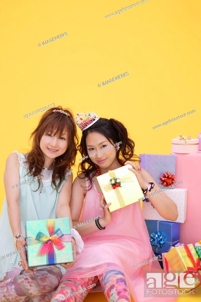 Stock Photo: Portrait of teenage girls with gift boxes.