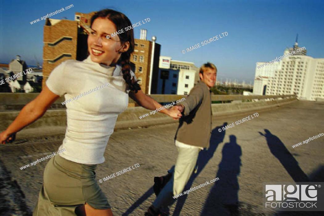Stock Photo: Couple running outdoors.