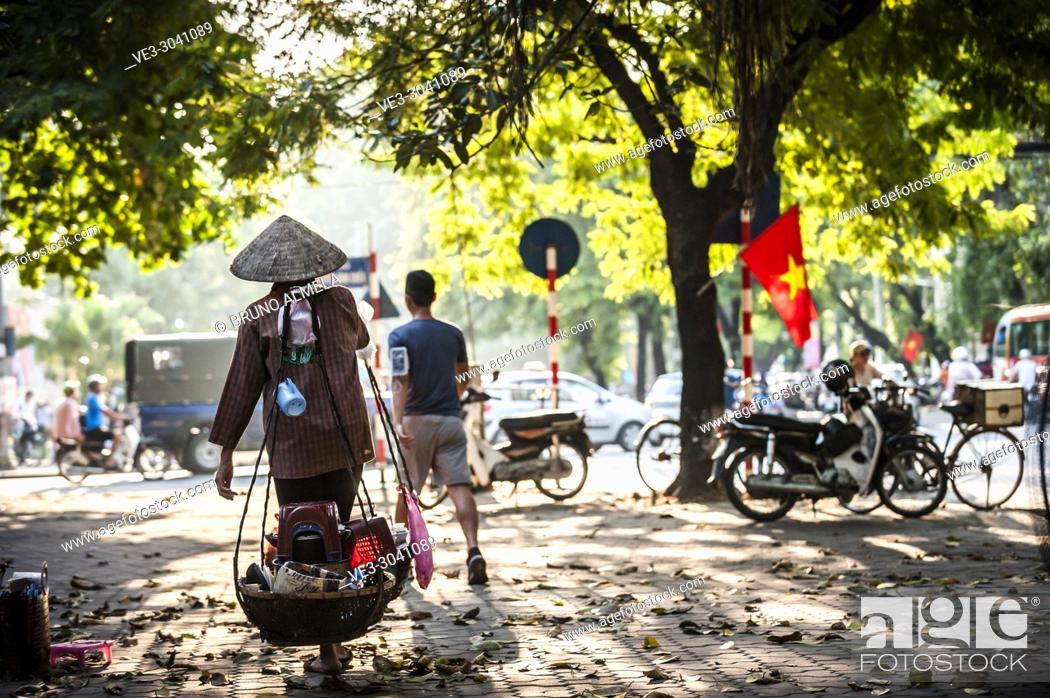 Stock Photo: Vietnamese street vendor in Hanoi, Vietnam.