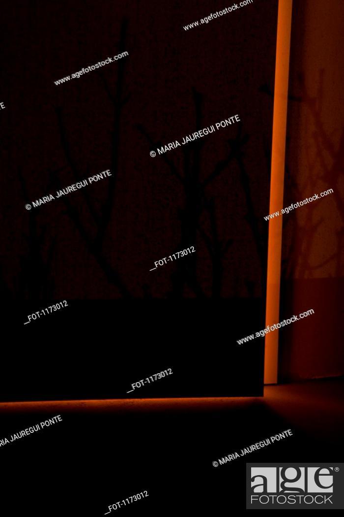 Stock Photo: Light surrounding ajar door.