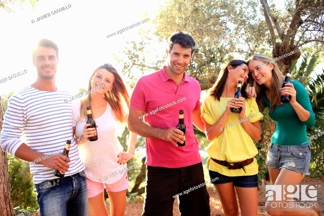 Stock Photo: Young people drinking beer.
