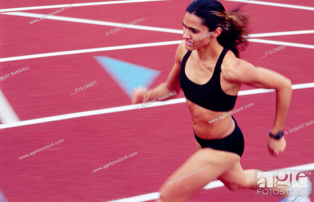 Stock Photo: Young woman training for race.